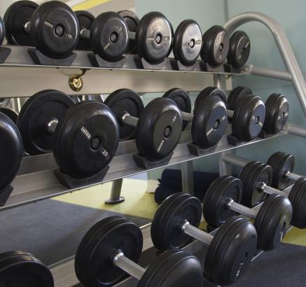 Camden San Marcos free weights in fitness center in Scottsdale, Arizona apartments.